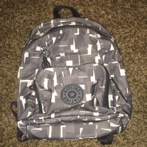 Gray and white Kipling backpack